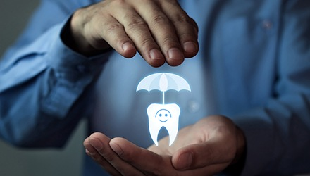 Man holding animated tooth under umbrella