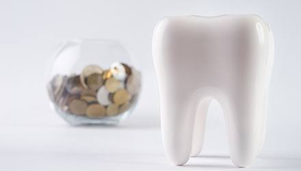 Tooth with bowl of coins